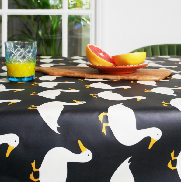 Anorak Waddling Ducks Cotton Coated Tablecloth (Black)